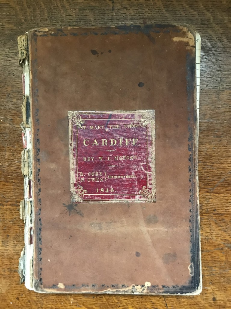Cover of an old book with the words St Mary the Virgin Cardiff.  Rev W.L. Morgan. R. Corey, J. Owen Churchwardes.  1846